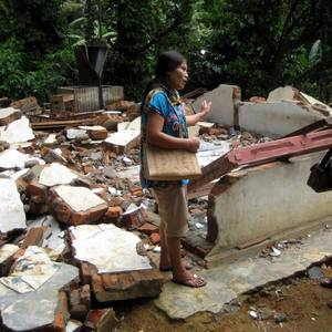 This is the woman's home after the earthquake